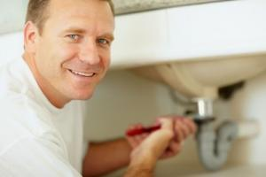one of our plumbing in Baldwin Park techs is fixing a sink